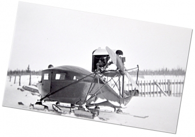Rear view of an early snowmobile