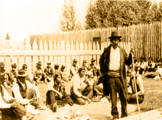 Blind Chief Missabay addressing the assembly before the feast held after the James Bay Treaty signing ceremony, Osnaburgh House, July 12, 1905.